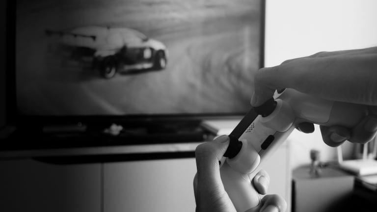 Man playing racing game