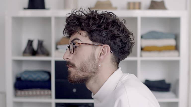 Guy with messy hair in profile.